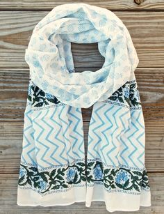 Blue Pineapple Fair Trade Scarf from Passion Lilie: One of our favorite scarves, because it features... blue pineapples! This fair trade scarf is made with a light- weight cotton and hand block printed with eco dyes. It also features a zig-zag and floral border.