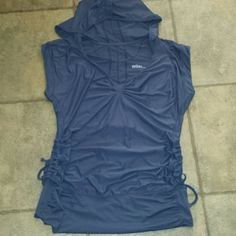 Zella size medium dark gray hooded yoga top Womens size medium Zella yoga top. Color is dark gray. V neck with hood & side tie ruching. Longer length & thick waistband. 91% polyester 9% spandex. Minor snagging on front but otherwise great! Zella Tops Tees - Short Sleeve