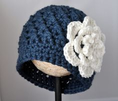 Crochet Chunky Flowered Cloche Pattern -- baby to adult sizes, not free. https://classycrochet.wordpress.com/2013/06/24/crochet-chunky-flowered-cloche-pattern/