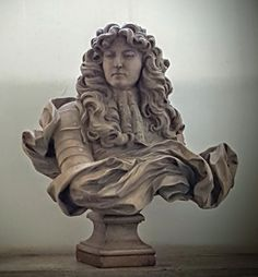 Bust in Castel Sant'Angelo. It seems to be a replica of a sculpture by Gian Lorenzo Bernini of  Louis XIV. The original is at the Palace of Versailles:   https://commons.wikimedia.org/wiki/File:Ch%C3%A2teau_de_Versailles,_salon_de_Diane,_buste_de_Louis_XIV,_Bernin_(1665)_03.jpg