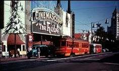 Grauman'sChinese Theater, 1953. Love the Pacific Electric Streetcar rolling down Hollywood Blvd.