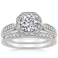 Not even a fan of having a halo, but this is beautiful...with a cushion cut of course  Platinum Victorian Halo Diamond Matched Set from Brilliant Earth