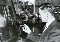 "Clyde Tombaugh using his blink comparator. It ""blinks"" back and forth between two photos taken at different times. Anything that has moved during that time can be spotted. This is how he found Pluto on February 18, 1930. (Credit: Science Photo Library) Mona Evans, ""Pluto Is a Dwarf Planet"" http://www.bellaonline.com/articles/art45809.asp"