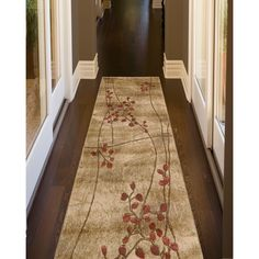 A unique floral design and luxurious pile highlight this machine-made rug. This area rug features shades of beige, brown and burgundy.