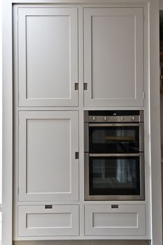 Create a clean design with these grey kitchen storage cabinets with integrated appliances