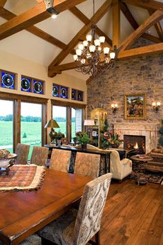 Great Room of Hillside Rancher. House Plan love the room and the beams in the ceiling.house plan not for me, ranch Craftsman Style House Plans, Luxury House Plans, The Ranch, Glass Design, Great Rooms, My Dream Home, Foyer, Living Room Designs, Decor Styles