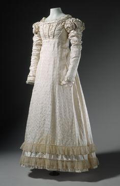 Young Womans Dress France, circa 1822 Costumes; principal attire (entire body) Self-patterned silk with silk satin and net trim Center back length: 45 in. (114.3 cm)