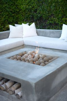 """Love the look of using the ceramic balls in a fire pit - 18 Inch Uniform 4"""" Ceramic Ball Set from blazingglass.com"""