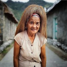 I've been to Batanes 11 times and have never photographed an Ivatan woman wearing the iconic traditional headwear of Batanes the vakul. So it was a pleasant surprise that on my last visit I saw Lola Fely of Chavayan Sabtang walking the almost empty street of her village late in the morning wearing a vakul. The sun was out and the heat was bearing down. And Lola Fely at 78 years young was cheerfully making her way towards her goats up in the mountains. She engaged us with her charm wit and… Batanes, Filipino, Never, Empty, Goats, Ethnic, Women Wear, Walking, Sun