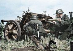German gunners of the 19th Panzer Division manning a 50 mm Pak 38 anti-tank gun.