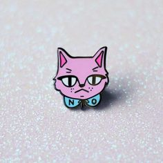 "Do you see this face? I am not amused with your sh*t right now. Flaunt your sassy side with this adorable cat pin! -1"" Black Nickel Plated Hard Enamel Pin with Rubber Backing -Shipped on a card in bub"