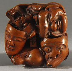 Lot 172: WOOD NETSUKE By Masakata. In the form of twelve theatrical masks. Signed. - Eldred's | Invaluable