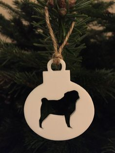 Our sleek pug silhouette, acrylic or wood baubles, are made to order and will complement any Christmas tree. Each bauble is made from 3mm White acrylic, which measures approx 7.5cm x 6cm and is finished with a piece of 3mm thick twine for hanging. Can be ordered in Black/Grey/White/Wood.