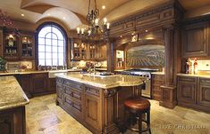 "GORGEOUS wood work.  i love the 14"" travertine tile floors and lighting fixtures.  it's very architectural and im in love!"