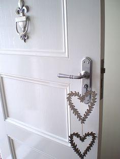 fleur de lis door knocker available through:  www.capecoddesigns.com.au