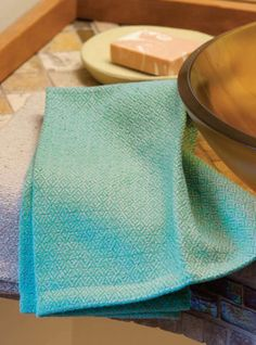 """Viking Era Towels Woven on any 4-shaft loom in twill; 24 epi; 17"""" weaving width with 8/2 Aurora Earth cotton."""