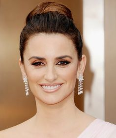 Penelope Cruz: Cruz paired her elegant high bun with sexy kohl-rimmed eyes, courtesy of makeup artist Charlotte Tilbury. Tarte's Inner Rim Liner ($18) in Black will give you an inky finish that lasts all night, at the 86th Annual Academy Awards. #PenelopeCruz #Oscars #RedCarpet