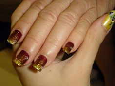 maroon and gold nail polish even if it is redskin colors i still like it