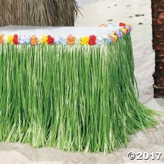 Tropical Flowered Table Skirt Looking for the perfect beach party decoration? This artificial grass table skirt is the essential party supply for a fabulous Hawaiian party! Lined with . Aloha Party, Luau Theme Party, Hawaiian Luau Party, Hawaiian Birthday, Tiki Party, Hawaiin Party Ideas, Ideas Party, Hawaiin Theme Party, Luau Party Ideas For Adults