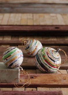 recycled paper ornaments- this is not a DIY but if you know how to make paper beads just experiment Old Christmas, Diy Christmas Ornaments, Christmas Balls, Homemade Christmas, Christmas Projects, Holiday Crafts, Recycled Christmas Decorations, African Christmas, Christmas Paper Crafts