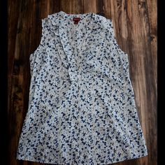 SALE Merona Sleeveless Ruffle Blouse GUC. Great for spring! Floral ruffle front sleeveless blouse. Has two button front and a tie in the back. Could also fit a size S. Merona Tops Tank Tops