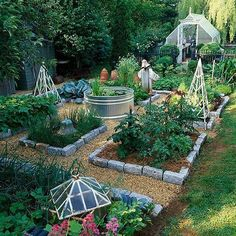 Raised bed vegetable garden with mulch paths and stone borders. A beautiful # raised bed . - Raised bed vegetable garden with mulch paths and stone borders. A beautiful # raised bed vegetable -