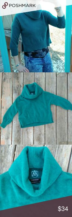 """Club Monaco Cashmere Cropped Sweater This 100% cashmere, cowl neck, 3/4 sleeve, cropped, teal sweater by Club Monaco is super fuzzy and warm! In great condition! Size small and fits true to size, see measurements. 21"""" wide at chest, total length is 17"""" long with a 5.5"""" slit on both sides. Club Monaco Sweaters Cowl & Turtlenecks"""