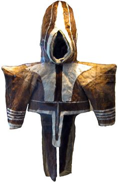 This is a Inuit womans parka (anarak) used for warmth. Made from summer Caribou. The hair is shorter and tighter knit for summer Caribou. This has been a traditional style for centuries.     by Leobudv, early 1900's