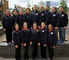 Team USA (Aly Raisman, Jordyn Wieber, McKayla Maroney, Kyla Ross, Gabby Douglas) with the coaches, team coordinator, and team doctor