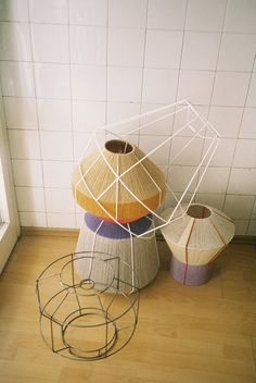 Cover metal frames of lampshades with twine, rope or wool