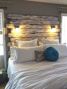 Recycled Pallet Headboard with Lights... Click through for lots of examples using reclaimed and weathered wood for headboards.
