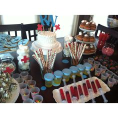 Nursing School Graduation party: I created this for my daughter's nursing school graduation party: urine cup & syringe jello shots, EKG cookies, nursing cap cupcakes, choc-dipped pretzel thermometers, cotton ball marshmallows, pill cup Skittles, dipped strawberries & Oreo truffles