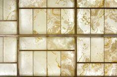 Backlit white onyx mosaic wall