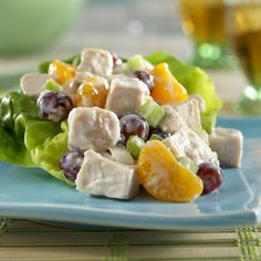Chicken Salad - Oranges and grapes complement this perfectly seasoned chicken salad. For super easy prep, purchase pre-cooked chicken at your grocery store.