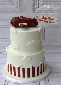 Vintage Airplane Baby Shower - I made this cake to match the recipients Shower invitation. Cake is covered in MMF and vintage Airplane is made out of rice cereal treats. TFL