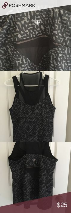 Lululemon sheer/mesh workout tank top- Size 4 Only worn a handful of times, great condition. It has a built-in bra and is made from really thick quality material. The top part is sheer/mesh and bottom is a black pattern. Great for working out! Very comfortable! lululemon athletica Tops Tank Tops