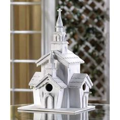 """Whitewashed country chapel is a wonder of woodwork and a heavenly haven for some blessed birdies. Three separate openings create a welcome for a whole flying congregation!  Weight 2 lbs. Clean-out hole on back. Wood. 7 7/8"""" x 6 1/4"""" x 12 3/4"""" high. Wood."""