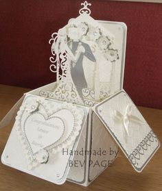 I nice idea for a wedding card. It fold up flat to fit into an envelope. Check out YouTube for tutorials. Pop up box card.