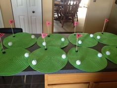 Golf themed party centerpieces made from dollar store mats, plastic gold balls hot glued on, and wooden skewers for the flags. Golf Centerpieces, Golf Party Decorations, Party Themes, Ideas Party, Centerpiece Ideas, Event Themes, Birthday Party Tables, 40th Birthday, 60 Birthday Party Ideas
