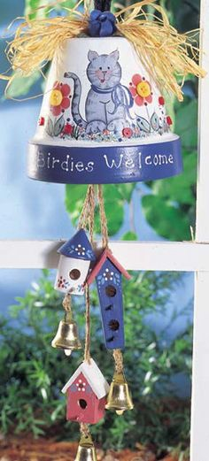 Birdies Welcome project from DecoArt. Painted pot, some bells and little wooden houses from the craft store