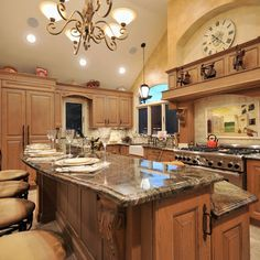 Mediterranean Kitchen- Cabinet on the side of kitchen island, two level counter, decorative finished edge