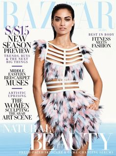 Australian model Shnaina Shaik is a vision in Fendi for the January 2015 cover from Harper's Bazaar Arabia. The dark-haired beauty wears a feather adorned dress with cut-out details as well as a slicked back hairdo. See a preview from Shanina's shoot below photographed by John Russo and styled by Sally Matthews.