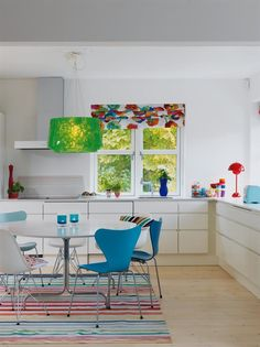 maybe keep neutral colours and use bright bar stools and maybe paint dining table
