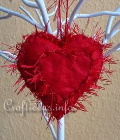 Valentine's Day ornament hanging from tree