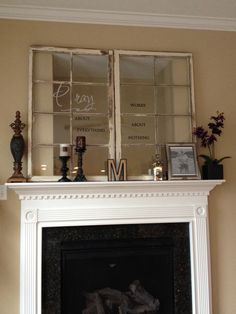 Re-purposed window frames to cover the awkward TV hole above the fireplace with wall writing on the glass. Love this!!