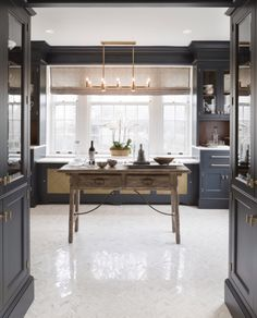 Floor to ceiling cabinets/textural contrast wall behind base cabinets