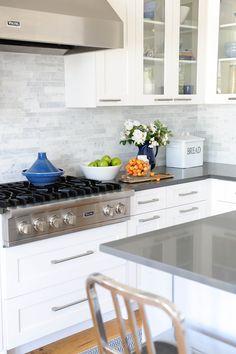 I like these drawer pulls.   glass-front white cabinets + marble backsplash + wood floor
