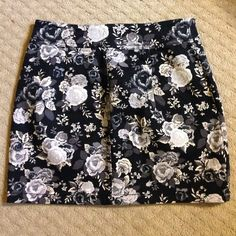 """H&M Floral mini skirt H&M black gray and white mini skirt size 6 .. Length is 15"""". Purchased from another posher too small  zips from waist to hem as shown in second pic  H&M Skirts Mini"""