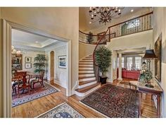 Elegance awaits you. Build by Don Potter this home located in The Point Village has the perfect location & upgraded features. Mahogany front doors w/ lead lined hand blown glass, graceful foyer with curved staircase. Wood lined walls in Study + office off back hallway by huge laundry rm. Butler Pantry w/ 250 bottle wine cooler, kitchen open to hearth room with stone FP. 2 bonus rms up one with Wet Bar, Refrig & Balcony. Salt Water pool/spa with auto fill. See Feature list in Attachments.