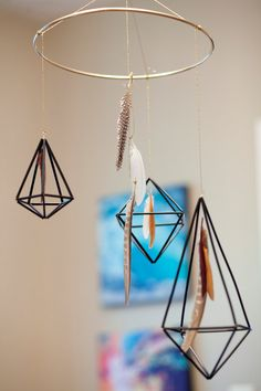 Black Geometric mobile with feathers. by NiftyNeat on Etsy